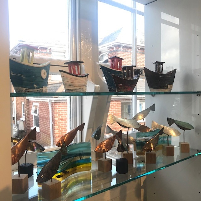 Various boats and fish souvenirs in a shop
