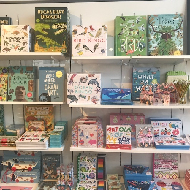 A selection of children's arts and craft books in a shop