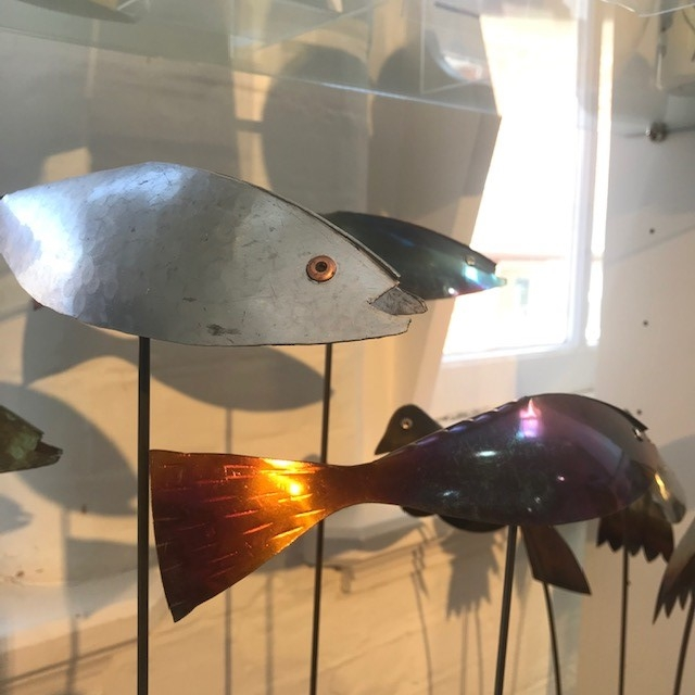 A metal fish souvenir in a shop