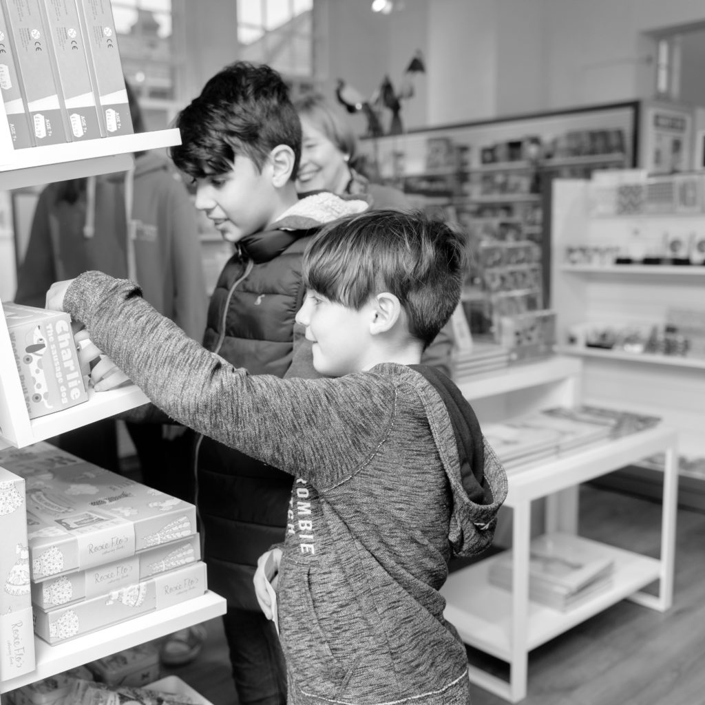 Children look at toys in the gift shop