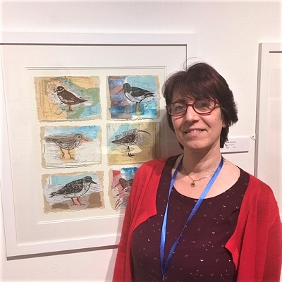 Woman standing by bird picture